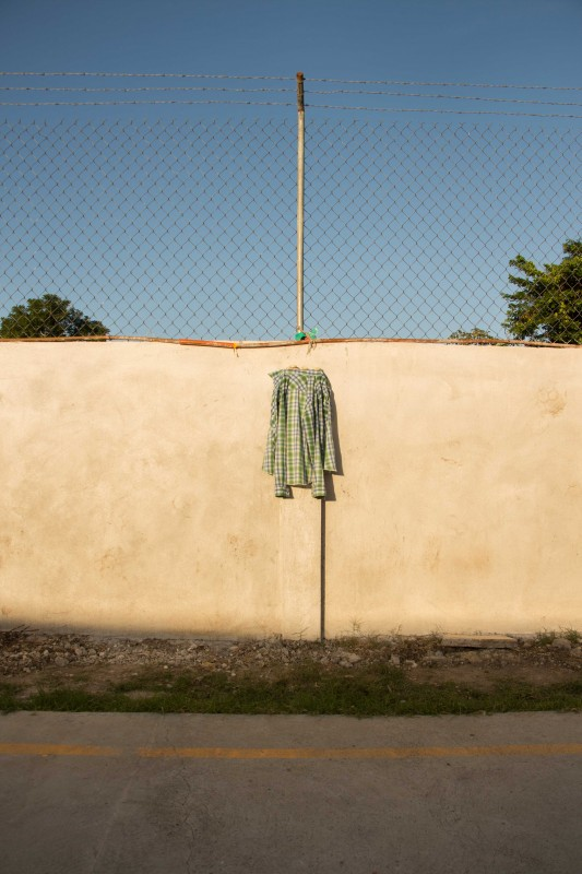 A migrant's shirt hung to dry at Albergue La 72 in Tenosique, Tabasco. Photo by Gabriela Bortolamedi.