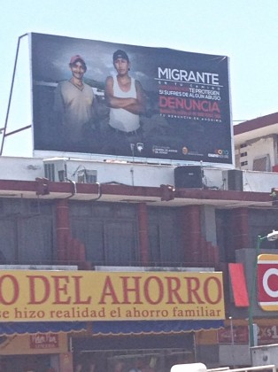 Billboard urging migrants to pursue legal action against rights violations over the central square in Tapachula