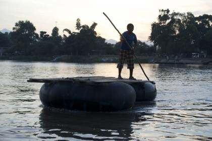 A man aboard a raft on the river. Río Suchaite. Photo by Diana Taylor.