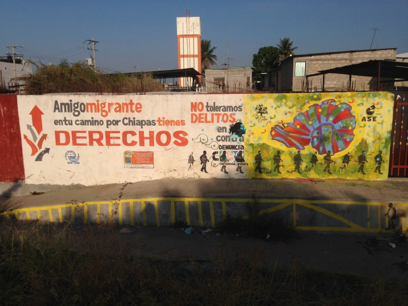 A graffiti sign on the Mexican side of the River Suchiate, facing migrants as they go across